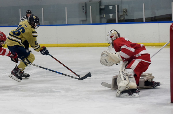 TIM JEAN/Staff photo <br /> <br /> Windham's Zach Jordan with a scoring chance during Tuscan Kitchen Blue Devil Classic boys hockey tournament against Pinkerton Academy at the ICenter in Salem, NH. Pinkerton won 3-2.    12/26/19