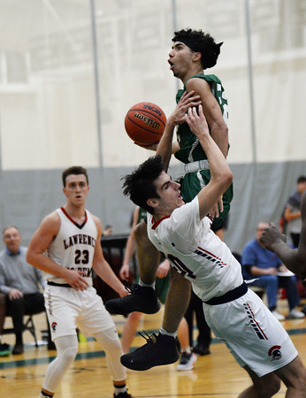CARL RUSSO/staff photo. Brooks' Tyler Whitney-Sidney fights his way to the hoop against Lawrence Academy's Brandon Wiercinski. Lawrence Academy at Brooks School in boys basketball action. 12/11/2019