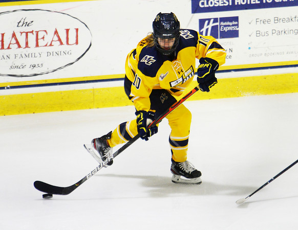 CARL RUSSO/Staff photo. Merrimack's Katie Kaufman moves the puck. The Merrimack College Warriors were defeated by the University of New Hampshire Wildcats in women's hockey action Friday night.12/06/2019