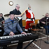 CARL RUSSO/Staff photo. STEPPING OUT: Santa Claus rings his bells while playing with the Holy Name Society's Christmas Party Band. Scott Andrews on keyboard, Dick Girard on drums, Victor Scionti (standing) on guitar and Dan Tully on acoustic guitar.<br /> <br /> The Holy Name Society of Corpus Christi Parish at Holy Rosary Church in Lawrence held its 59th. Annual Christmas Party for Exceptional Adults and Children on Sunday, December 1st. at the Parish Center. <br /> <br /> Over one hundred guest, family members and caregivers were treated to a Pasta and meatball dinner and a large Christmas cake for dessert. The highlight of the party was a visit from Santa who handed out Christmas gifts. The music was provided by The Holy Name Society's Christmas Party Band. 12/1/2019