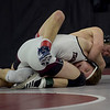 TIM JEAN/Staff photo <br /> <br /> Central's Mike Glynn, top, wrestles against Timberlane's Cody Wild during the 138 pound final match in the George Bossi Lowell Holiday Wrestling Tournament.  12/28/19
