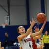 TIM JEAN/Staff photo <br /> <br /> North Andover's Hannah Martin drives to the hoop against Natick during the Commonwealth Motors Christmas Classic basketball tournament.   12/28/19