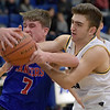 TIM JEAN/Staff photo <br /> <br /> Londonderry's Luke Marsh battles for the rebound with Andover's Jack Cloutier during the Commonwealth Motors Christmas Classic basketball tournament. Londonderry defeated Andover 55-53.     12/27/19