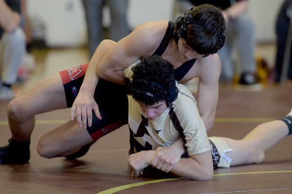 TIM JEAN/Staff photo <br /> <br /> North Andover's Carson Milovanovic, top, is in control of Haverhill's Jesse Rodriguez before pinning him in the 126 pound wrestling match.     12/24/19