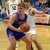 TIM JEAN/Staff photo <br /> <br /> Londonderry's Luke Marsh looks to pass while being defended by Andover's Michael Slayton during the Commonwealth Motors Christmas Classic basketball tournament.   12/27/19