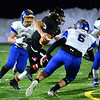 CARL RUSSO/Staff photo. Greater Lawrence quarterback, Shamil Diaz finds running room surrounded by Assabet Valley defenders. Greater Lawrence Tech. defeated Assabet Valley 36-26 in State Vocational Bowl Thursday night. 12/05/2019