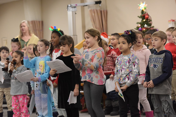 TIM JEAN/Staff photo <br /> <br /> Students from Hill View Montessori Public Charter School sing holiday songs to patients and staff at Whittier Rehabilitation Hospital.   12/20/19