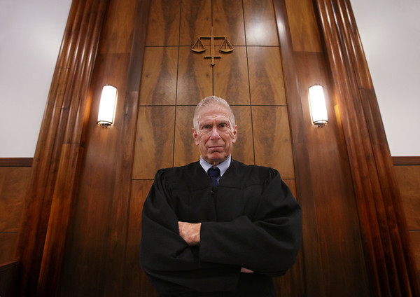 MIKE SPRINGER/Staff photo<br /> First Justice Stephen Abany stands at the bench Monday in Haverhill District Court. Abany is retiring Dec. 17 after 14 years as First Justice.<br /> 12/9/2019