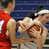 TIM JEAN/Staff photo <br /> <br /> Andover's Shea Krekorian, right, rips the ball away from Natick's Maya Stopka during the Commonwealth Motors Christmas Classic basketball tournament. Natick defeated Andover 52-37.  12/31/19