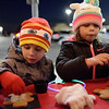 TIM JEAN/Staff photo <br /> <br /> Andrew Taurus, 5, and his sister Isabella, 7, both of Methuen, decorate gingerbread cookies during the Methuen tree lighting festivities at The Loop shopping center.   12/7/19