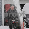 TIM JEAN/Staff photo <br /> <br /> John DeMatos of Methuen, uses a snowblower to clear his driveway during the second half of a long-duration snowstorm.  12/3/19