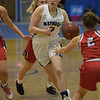 TIM JEAN/Staff photo <br /> <br /> Methuen's Olivia Barron splits the Tewksbury defenders and drives to the hoop and scores during a girls basketball game. Methuen lost 49-26.     12/19/19