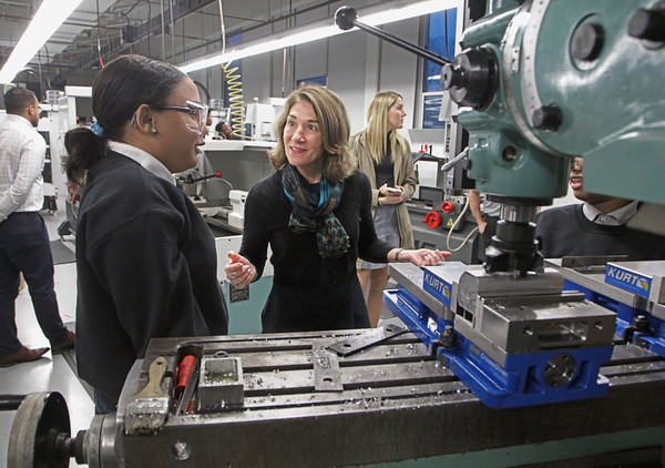 MIKE SPRINGER/Staff photo<br /> Lt. Gov. Karyn Polito visits with Greater Lawrence Technical School senior Lixandra Andujar, left, during a tour of the school's machine tool technology shop Tuesday in Andover. Polito visited the school to announce a $2.5 million grant to four regional consortiums through the Advanced Manufacturing Training Program.<br /> 12/10/2019