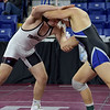 TIM JEAN/Staff photo <br /> <br /> Timberlane's Brendan Young, left, wrestles against Merrimack's Griffin Ostrom during the 195 pound final match in the George Bossi Lowell Holiday Wrestling Tournament.  12/28/19