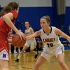 TIM JEAN/Staff photo <br /> <br /> North Andover's Sara Melody, right, plays defense against Natick's Brenna McDonald during the Commonwealth Motors Christmas Classic basketball tournament.   12/28/19