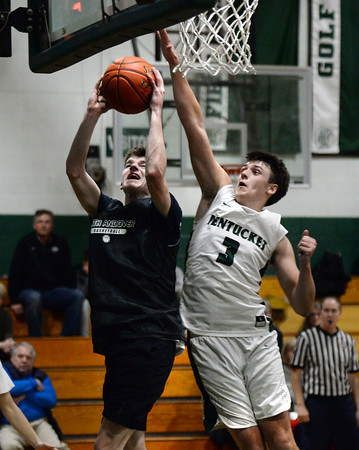 CARL RUSSO/Staff photo. North Andover's Matt Kutz drives under the hoop against Pentucket's Peter Cleary. North Andover defeated Pentucket in boys basketball scrimmage game Tuesday afternoon. 12/10/2019