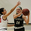 TIM JEAN/Staff photo <br /> <br /> Central's Juliana Porto, left, defends against Pentuck's Angelica Hurley during the Commonwealth Motors Christmas Classic basketball tournament. Pentuck defeated Central 38-36.  12/31/19