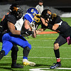 CARL RUSSO/Staff photo. Greater Lawrence's Jeremy Rizzo, left and Shamil Diaz tackle Assabet Valley runner.  Greater Lawrence Tech. defeated Assabet Valley 36-26 in State Vocational Bowl Thursday night. 12/05/2019