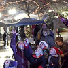 TIM JEAN/Staff photo <br /> <br /> Children reach up for the giant bubbles as they wait for the lighting of the tree during the annual Christmas Stroll in Haverhill.   12/6/19