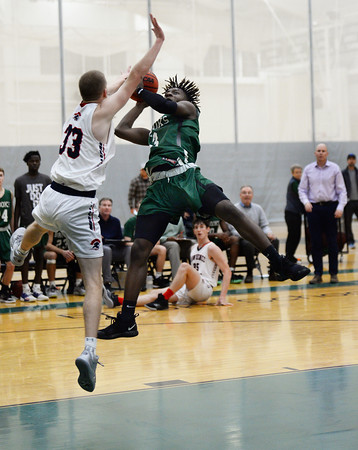 CARL RUSSO/staff photo. Brooks' Darrel Yepdo is fouled by Lawrence Academy's Tommy Fontanella as he sails to the hoop. Lawrence Academy at Brooks School in boys basketball action. 12/11/2019