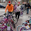 TIM JEAN/Staff photo <br /> <br /> Construction workers from Brady Sullivan Properties, who are building apartments in the Pacific Mills Lofts carry bicycles to City Hall that are being donated to Lawrence.     12/13/19