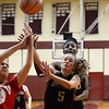 CARL RUSSO/Staff photo. Whittier's Alicia Habib, 5 and Grace Efosa fight for the rebound with Lynn Tech player. Whittier Tech scrimmaged against Lynn Tech in girls basketball action Monday afternoon. 12/09/2019