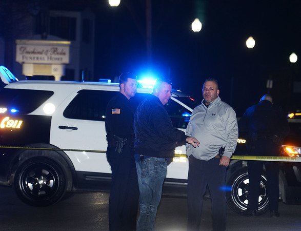 """CARL RUSSO/Staff photo. Methuen police captain Kris McCarthy, center, and officer Sean Fountain, right and other officers investigate the shooting. <br /> <br /> An """"unknown assailant"""" shot a 24-year-old man while he was walking on Broadway Tuesday evening, police said. The victim was shot at several times and hit once, according to Detective Lt. Michael Pappalardo, who was at the scene investigating. The Fire Department transported the man to a local hospital for treatment of a non-life-threatening injury, Pappalardo said.The shooting happened at Broadway and Center Street at around 7:25 p.m. Multiple 911 calls reported the incident to police. Two hours after the shooting, the section of Broadway in front of the Sonrisa Market was blocked by crime scene tape. Part of Center Street was also closed as state and Methuen police officers investigated. Police """"recovered items of an evidentiary nature"""" at the scene, said Pappalardo, who didn't go into further details. No arrests had been made as of Tuesday night. Anyone with information about the shooting is asked to call Methuen police at 978-983-8698. The Massachusetts State Police Crime Scene Services Section assisted Methuen detectives with the investigation. 12/24/2019"""