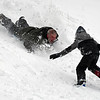 RYAN HUTTON/ Staff photo<br /> Dylan Matthews, 6, runs toward his dad David as he sleds down the sledding hill at Alexander Carr Park in Derry on Monday.
