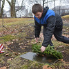 TIM JEAN/Staff photo <br /> <br /> Richard Dow, 10, of Haverhill, places a wreath on a veterans grave during the Wreaths Across America remembrance day in Haverhill's Hilldale Cemetery.       12/14/19