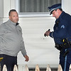"""CARL RUSSO/Staff photo. Methuen police officer Sean Fountain, left, and  Mass. State Police Sgt. Ed Johnson examine a bullet hole in the home at 73 Broadway, next to Sonrisa Market, which 75 Broadway.  <br /> <br /> An """"unknown assailant"""" shot a 24-year-old man while he was walking on Broadway Tuesday evening, police said. The victim was shot at several times and hit once, according to Detective Lt. Michael Pappalardo, who was at the scene investigating. The Fire Department transported the man to a local hospital for treatment of a non-life-threatening injury, Pappalardo said.The shooting happened at Broadway and Center Street at around 7:25 p.m. Multiple 911 calls reported the incident to police. Two hours after the shooting, the section of Broadway in front of the Sonrisa Market was blocked by crime scene tape. Part of Center Street was also closed as state and Methuen police officers investigated. Police """"recovered items of an evidentiary nature"""" at the scene, said Pappalardo, who didn't go into further details. No arrests had been made as of Tuesday night. Anyone with information about the shooting is asked to call Methuen police at 978-983-8698. The Massachusetts State Police Crime Scene Services Section assisted Methuen detectives with the investigation. 12/24/2019"""