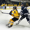 CARL RUSSO/Staff photo. Merrimack's Gabby Jones fights for the puck. The Merrimack College Warriors were defeated by the University of New Hampshire Wildcats in women's hockey action Friday night.12/06/2019