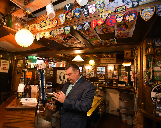 RYAN HUTTON/ Staff photo<br /> Peddler's Daughter owner Michael Conneely pours a Guinness at the tap.