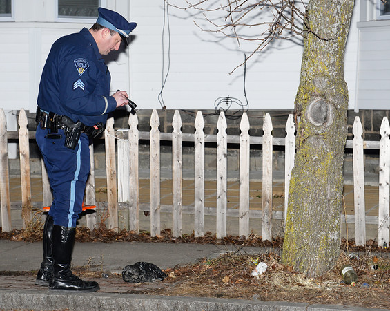 """CARL RUSSO/Staff photo. Mass. State Police Sgt. Ed Johnson searches for shell casings in the area of 73-75 Broadway next to Sonrisa Market. <br /> <br /> An """"unknown assailant"""" shot a 24-year-old man while he was walking on Broadway Tuesday evening, police said. The victim was shot at several times and hit once, according to Detective Lt. Michael Pappalardo, who was at the scene investigating. The Fire Department transported the man to a local hospital for treatment of a non-life-threatening injury, Pappalardo said.The shooting happened at Broadway and Center Street at around 7:25 p.m. Multiple 911 calls reported the incident to police. Two hours after the shooting, the section of Broadway in front of the Sonrisa Market was blocked by crime scene tape. Part of Center Street was also closed as state and Methuen police officers investigated. Police """"recovered items of an evidentiary nature"""" at the scene, said Pappalardo, who didn't go into further details. No arrests had been made as of Tuesday night. Anyone with information about the shooting is asked to call Methuen police at 978-983-8698. The Massachusetts State Police Crime Scene Services Section assisted Methuen detectives with the investigation. 12/24/2019"""