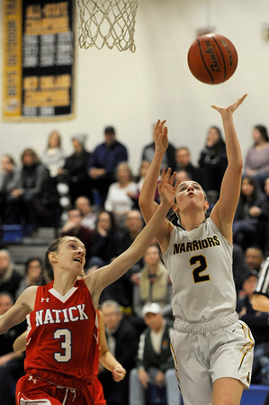 TIM JEAN/Staff photo <br /> <br /> Andover's Shea Krekorian, right, shoots and scores while being defended by Natick's Maggie Lagan during the Commonwealth Motors Christmas Classic basketball tournament. Natick defeated Andover 52-37.  12/31/19