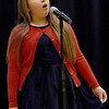 TIM JEAN/Staff photo <br /> <br /> Sophia Salas, 9, sings holiday songs during the KDuran Music Christmas concert at Esperanza Academy in Lawrence.      12/21/19