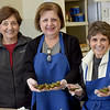 TIM JEAN/Staff photo <br /> <br /> Ann Apovian, left, Sossy Jeknavorian, and Gail Baderian prepare stuffed grape leaves for the Holiday Fair in the kitchen of Jaffarian Hall in St. Gregory Armenian Church of the Merrimack Valley in North Andover.   12/4/19