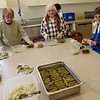 TIM JEAN/Staff photo <br /> <br /> From left to right, Arpie Metrebian, Mary Barooshian, and Gail Baderian prepare stuffed grape leaves for the Holiday Fair in the kitchen of Jaffarian Hall in St. Gregory Armenian Church of the Merrimack Valley in North Andover.   12/4/19