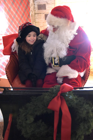 TIM JEAN/Staff photo <br /> <br /> Olivia Sullivan, 7, of Tyngsboro tells Santa what she would like for Christmas at Smolak Farms in North Andover.    12/21/19
