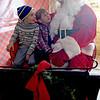 TIM JEAN/Staff photo <br /> <br /> Benicio Rodriguez, left, and his friends Thomas Klein, both 5, from Winchester visits with Santa at Smolak Farms in North Andover.    12/21/19