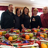 RYAN HUTTON/ Staff photo<br /> Members of the AHEPA Acropolis Chapter 39 with some of the 84 food baskets they are assembling for lonely seniors this holiday season. From left are Charlie Antonopoulos, chapter secretary, Felicia Antonopoulos, Tatiana Bobr, Elaine Tzitzon and James Tzitzon, chapter president.
