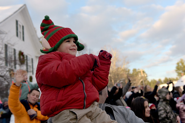 TIM JEAN/Staff photo <br /> <br /> Lincoln Teixeira, 3, of Windham, is all smiles as he sees Santa arrive by a fire truck outside of the Windham Town Hall during the Windham Tree lighting celebration.  12/7/19