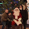 TIM JEAN/Staff photo <br /> <br /> Posing for a family photos with Santa are from left, Paul O'Neil, his son Declan, 6, and Stephanie Davis, all of Methuen, during the Methuen tree lighting festivities at The Loop shopping center.   12/7/19