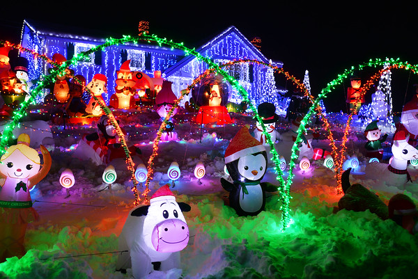 CARL RUSSO/Staff photo. Over the past 15 years Kendra and Keith Sanzo of Pelham and their children have put in thousands of hours to set up their front yard Christmas lights display. This year they doubled the effort which now includes 107 inflatable decorations, dozens of figurines and over 100,000 lights. Lights on every day 2:30-11pm. 12/02/2019