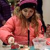 TIM JEAN/Staff photo <br /> <br /> Leah Casey, 7, of Atkinson, decorates a cookie at Pentucket Bank's Santa's Village at Harbor Place during the Haverhill Chamber of Commerce annual Christmas Stroll in Haverhill.   12/6/19