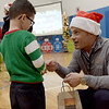 TIM JEAN/Staff photo <br /> <br /> Joe Faro, right, Tuscan Brands owner passes out gift cards to members of the Boys and Girls Club of Greater Salem.   12/18/19
