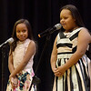 TIM JEAN/Staff photo <br /> <br /> Nicki Ramire, 8, left, and Ashley Garcia, 10, sing holiday songs on stage during the KDuran Music Christmas concert at Esperanza Academy in Lawrence.      12/21/19