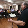 MIKE SPRINGER/Staff photo<br /> Conductor David Hodgkins leads the New England Classical Singers in a rehearsal Monday at South Church in Andover.<br /> 12/9/2019