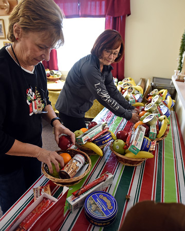 RYAN HUTTON/ Staff photo<br /> Elaine Tzitzon, left, and Felicia Antonopoulos, right, assemble holiday food baskets as part of the AHEPA Acropolis Chapter 39's project to bring gifts to lonely seniors in Haverhill.