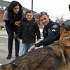 RYAN HUTTON/ Staff photo<br /> Aiden Moore, 8,  and his mom Jillian Mackenzie-Moore interact with Clinton, CT Police Officer Jason Frey and his K-9 partner Sonny outside the Derry Police Department on Friday morning. Nearly a dozen police dogs and their handlers showed up to help present Aiden's family with a handicap accessible van which they will need as his Duchenne Muscular Dystrophy worsens.