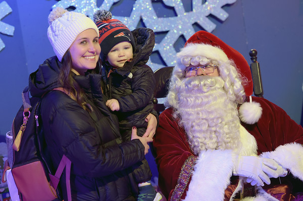 TIM JEAN/Staff photo <br /> <br /> Kristen Gallagher of Haverhill, holds her son Cameron, 18 months old, as they have a photo taken with Santa at Pentucket Bank's Santa's Village at Harbor Place during the annual Christmas Stroll in downtown Haverhill. The event is sponsored by the Haverhill Chamber of Commerce.  12/6/19